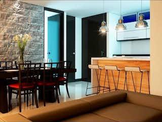 Una sala de estar llena de muebles y una ventana en Quartier