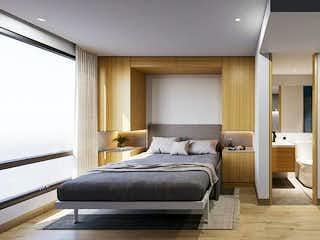 Una habitación de hotel con dos camas y una lámpara de araña en Vivo 52