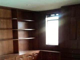 Una vista de una sala de estar con suelos de madera en Apartamento En Venta En Bogota San Patricio