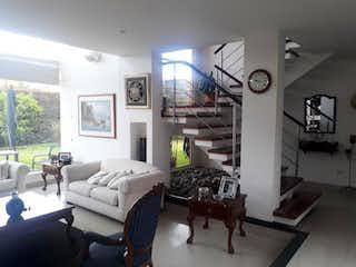 Una sala de estar llena de muebles y una gran ventana en Casa en Cota, Cota - Hacienda Terracota de dos niveles