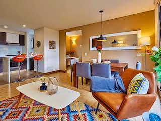 Una sala de estar llena de muebles y una televisión de pantalla plana en Haciendas de la Sabana aptos