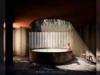 Un baño con una bañera y una ventana en Casa Tezontle