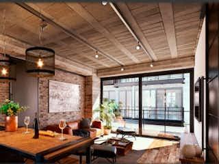 Un comedor con una mesa y sillas en Portello Lofts