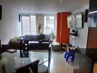 Una sala de estar llena de muebles y una televisión de pantalla plana en Apartamento en venta en Santa Isabel, 90mt