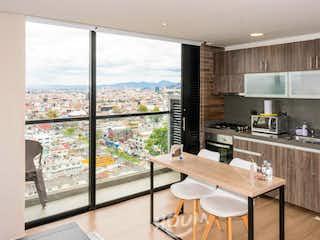 Una cocina con un gran ventanal y un gran ventanal en Apartamento en Los Alcázares, Los Alcázares. 1 habitación. 40 m2