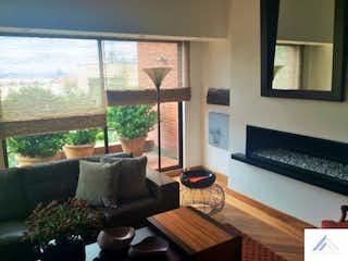 Una sala de estar llena de muebles y una chimenea en Apartamento en Bosque Medina, Usaquen - Tres alcobas