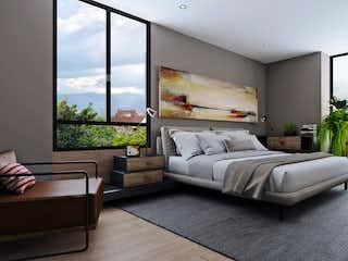 Una sala de estar llena de muebles y una gran ventana en CityM Laureles