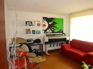 Una sala de estar llena de muebles y una televisión de pantalla plana en Condominio