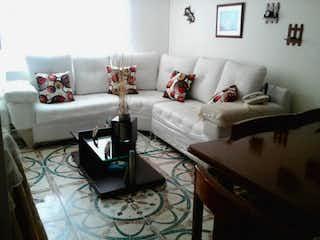 Una sala de estar llena de muebles y un sofá en Conjunto