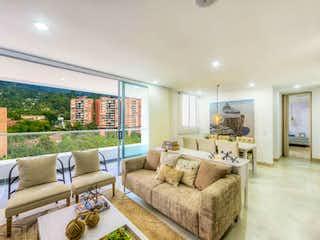 Una sala de estar llena de muebles y una gran ventana en Nativo Agua
