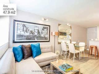 Una sala de estar llena de muebles y una mesa en Aragón