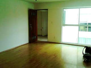 Una habitación que tiene una ventana en ella en Departamento en venta en Portales Norte con elevador