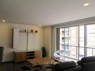 Una sala de estar llena de muebles y una ventana en Apartamento en Sotavento, Suba - 95 mt2, sexto piso, tres alcobas