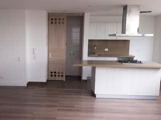 Una cocina con fregadero y nevera en Edificio Tribeca