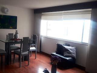Una sala de estar llena de muebles y una televisión de pantalla plana en Venta Apartamento Gran Granada (Villas de Granada)