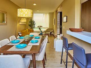 Una sala de estar llena de muebles y una lámpara de araña en Haciendas de la Sabana 2, Casas