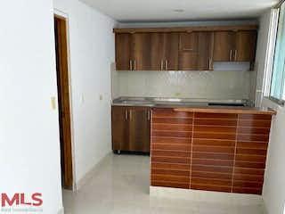 Una cocina con armarios de madera y un suelo de madera en No aplica