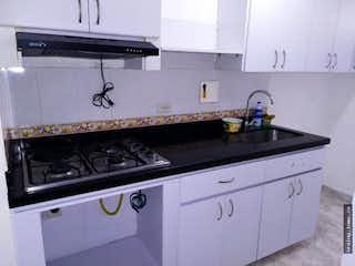 Una estufa blanca encima del horno sentado dentro de una cocina en Apartamento en venta en El  Dorado, Envigado.