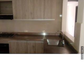 Una cocina con un fregadero y una estufa en Apartamento en venta en Aragon, Prado.