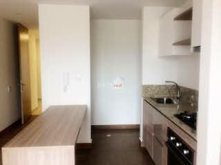 Una cocina con un fregadero y un horno de cocina en Apartaestudio en Cajicá, Cundinamarca con chimenea-56mt2