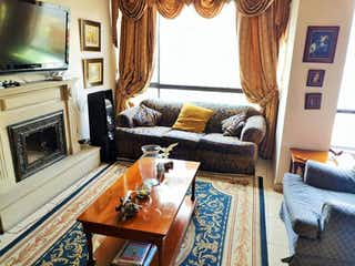 Una sala de estar llena de muebles y una chimenea en Apartamento En Venta En Bogota Ciudad Salitre Nor-Oriental-Teusaquillo