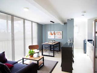 Una sala de estar llena de muebles y una chimenea en Apartamento en rionegro - 57 mts, 1 parqueadero.