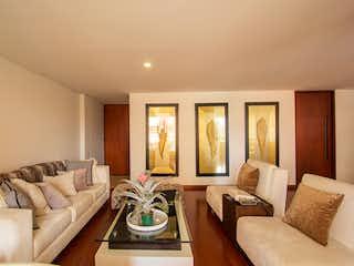 Una sala de estar llena de muebles y una gran ventana en Apartamento en venta en Usaquén de  3 habitaciones