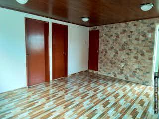 Una cama sentada en un dormitorio junto a una pared en Apartamento en Fontibón, Centro con 3 habitaciones-60 mts.