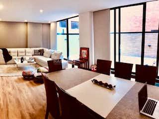 Una sala de estar llena de muebles y una gran ventana en Apartamento en San Patricio, Santa Barbara con tres alcobas, terraza - 223 mt2.