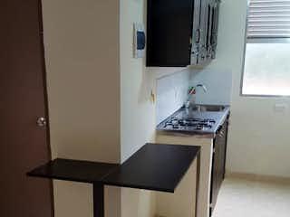 Una cocina con lavabo y microondas en Apartamento en  el Trapiche - 2 habitaciones