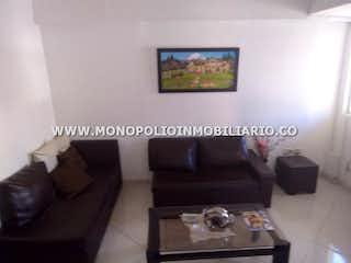 Una sala de estar llena de muebles y una pintura en Casa Bifamiliar en Simon Bolivar, La America con 4 alcobas - 138 mt2.