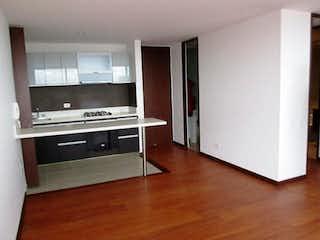 Una cocina con una estufa y un refrigerador en torres de Kandinsky