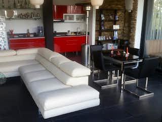 Una sala de estar llena de muebles y una gran ventana en Casa de 1600m2 en La Calera, con cinco habitaciones