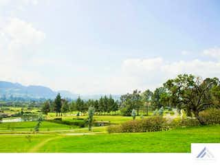 Una vista de un campo con árboles en el fondo en Reserva de Potosí