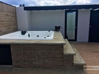Un cuarto de baño con lavabo y bañera en Apartamento duplex en Alto de Palmas, con terraza y 1 habitación - 75 mt2.