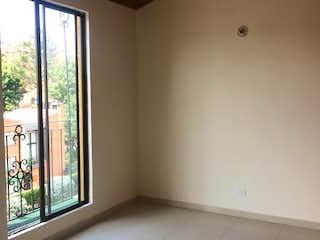Una vista de una habitación con un gran ventanal en El Mirador del Parque ll