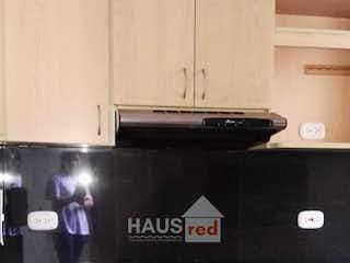 Cocina con fogones y microondas en -
