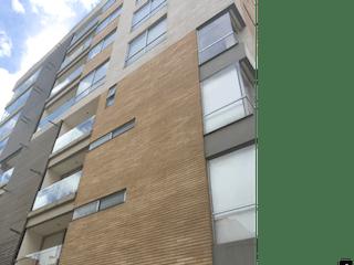Un edificio de ladrillo marrón con una ventana blanca en Venta apto Chico-985264