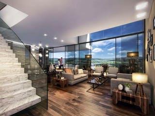 Una sala de estar llena de muebles y una ventana en Punta Pérgola