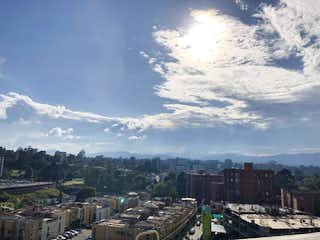 Una vista de una ciudad con un horizonte de la ciudad en el fondo en Apartamento en Venta RIONEGRO