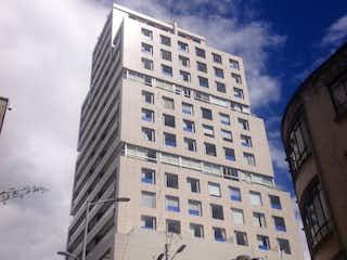 Un edificio alto sentado al lado de un edificio alto en Apartamento en Venta LAS NIEVES