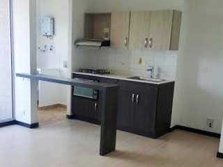 Una cocina con un horno de cocina y un fregadero en Arboleda La Estrella