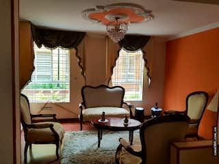 Una sala de estar llena de muebles y una ventana en VENTA CASA HAYUELOS (FONTIBON)