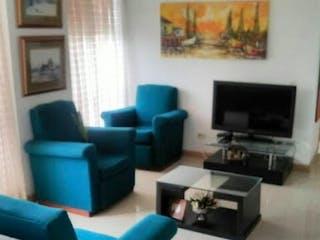 Una sala de estar llena de muebles y una televisión de pantalla plana en  LIVING