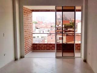 Una vista de una habitación con una puerta corredera de cristal en EDIFICIO JARDINES