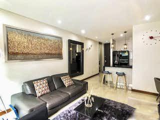 Una sala de estar llena de muebles y una televisión de pantalla plana en AGRADABLE APTO EN MODERNO EDIFICIO – VENTA – Cll 101 Cra19A – CHICO NAVARRA