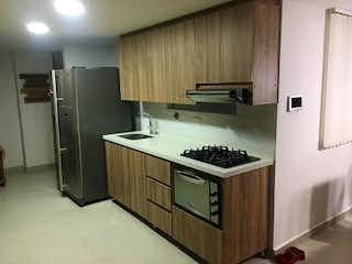 Una cocina con una estufa y un fregadero en Montesion
