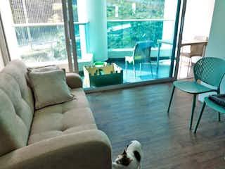 Una sala de estar llena de muebles y una ventana en Apartaestudio en Aves Maria, Sabaneta - Una alcoba