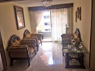 Una sala de estar llena de muebles y una ventana en Apartamento en Cuarta Brigada, Estadio - Tres alcobas