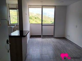 Una cocina con un gran ventanal y un piso rosado en Puerto Alegre - Unidad Residencial